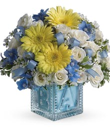 Dazzling white spray roses, light blue delphinium, white waxflower
