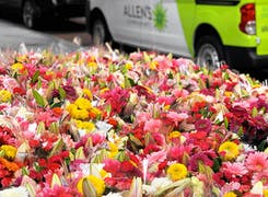 Dozens of bright, spring-themed bouquets awaiting delivery
